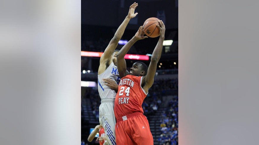 Austin Peay's Ed Dyson (24) shoots in front of Memphis' Nick King in the second half of an NCAA college basketball game in Memphis, Tenn., Thursday, Nov. 14, 2013. Memphis defeated Austin Peay 95-69. (AP Photo/Danny Johnston)