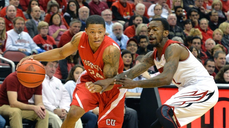 Cornell's Devin Cherry, right, attempts to drive around the defense of Louisville's Russ Smith during the first half of an NCAA college basketball game on Friday, Nov. 15, 2013, in Louisville, Ky. (AP Photo/Timothy D. Easley)