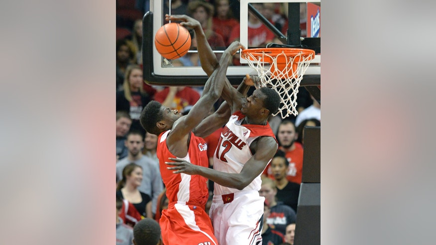 Louisville's Mangok Mathiang, right, blocks the shot of Cornell's David Onuorah during the second half of an NCAA college basketball game on Friday, Nov. 15, 2013, in Louisville, Ky. Louisville defeated Cornell 99-54. (AP Photo/Timothy D. Easley)