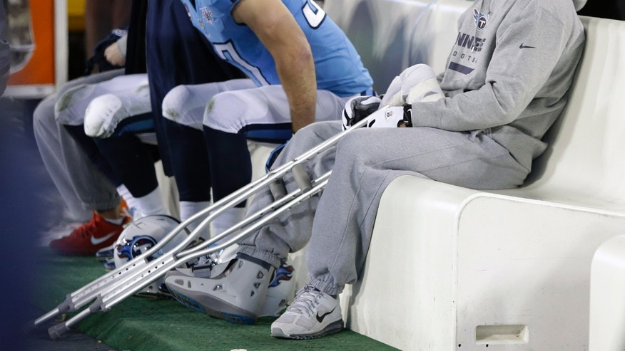 Injured Tennessee Titans quarterback Jake Locker sits on the bench in the second quarter of an NFL football game between the Titans and the Indianapolis Colts on Thursday, Nov. 14, 2013, in Nashville, Tenn. (AP Photo/Wade Payne)