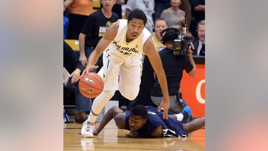 Colorado's Spencer Dinwiddie, top, leaves Jackson State's Derell Taylor during the first half of an NCAA college basketball game Saturday, Nov. 16, 2013, in Boulder, Colo. (AP Photo/The Daily Camera, Cliff Grassmick) NO SALES