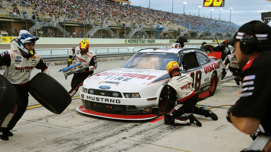 Brad Keselowski makes a pit stop during the NASCAR Nationwide Series auto race at Homestead-Miami Speedway in Homestead, Fla., Saturday, Nov. 16, 2013. (AP Photo/Terry Renna)