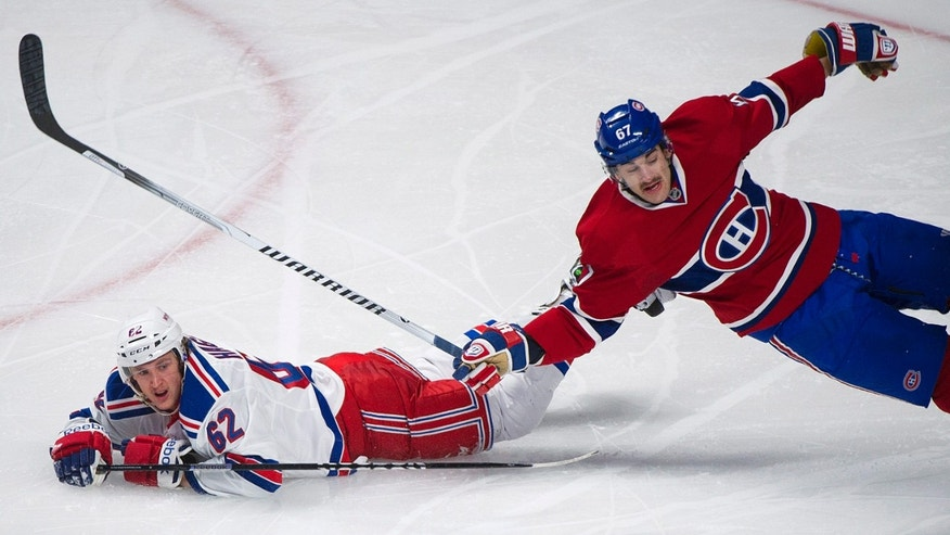 Montreal Canadiens' Max Pacioretty, right, collides with New York Rangers' Carl Hagelin during the second period of an NHL hockey game Saturday, Nov. 16, 2013, in Montreal. (AP Photo/The Canadian Press, Graham Hughes)