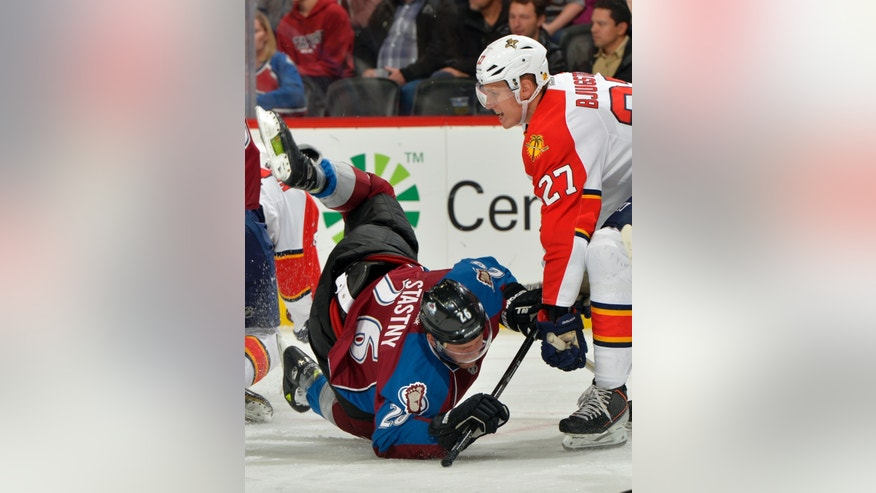 Colorado Avalanche center Paul Stastny (26) trips against Florida Panthers center Nick Bjugstad (27) during the first period of an NHL hockey game, Saturday, Nov. 16, 2013, in Denver. (AP Photo/Jack Dempsey)