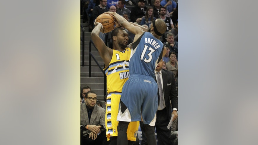 Minnesota Timberwolves forward Corey Brewer (13) reaches for the ball against Denver Nuggets forward Jordan Hamilton (1) during the first quarter of an NBA basketball game in Denver, Friday, Nov. 15, 2013. (AP Photo/Joe Mahoney)