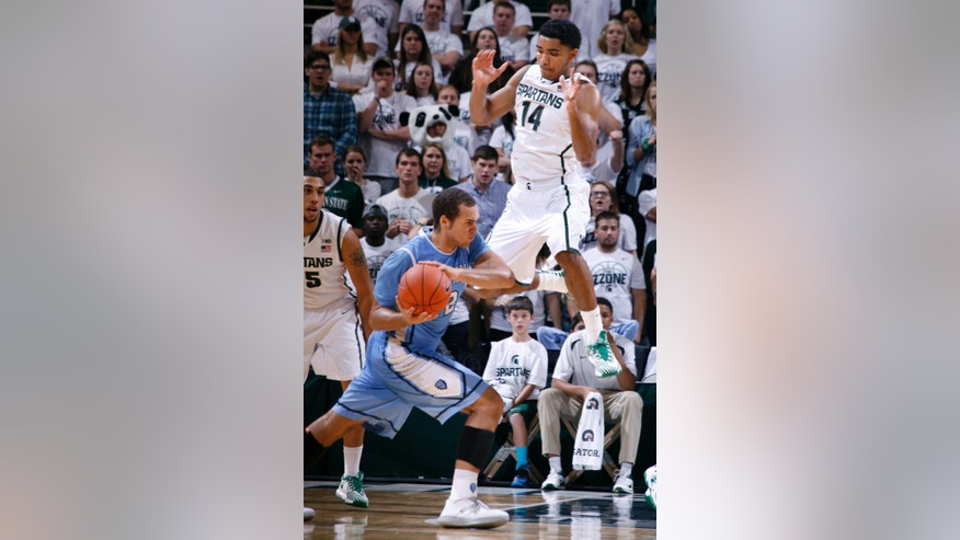Michigan State's Gary Harris (14) pressures Columbia's Isaac Cohen during the second half of an NCAA college basketball game, Friday, Nov. 15, 2013, in East Lansing, Mich. Michigan State won 62-53. (AP Photo/Al Goldis)
