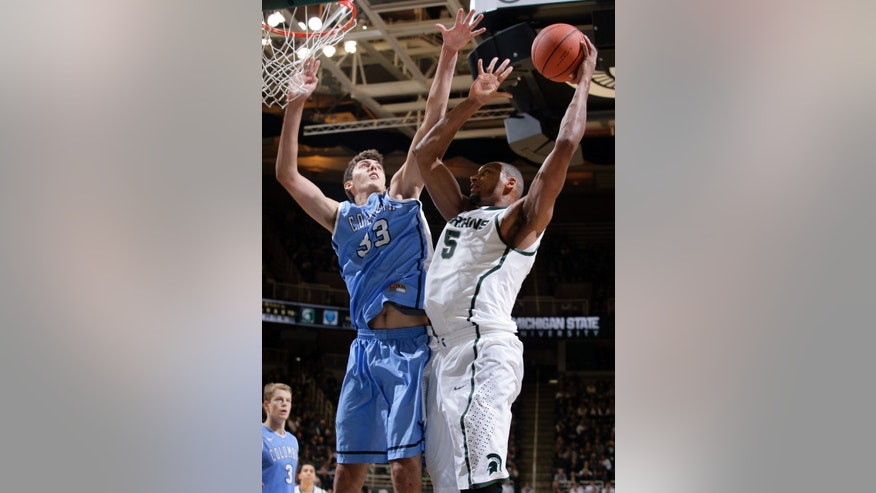 Michigan State's Adreian Payne (5) shoots against Columbia's Luke Petrasek during the second half of an NCAA college basketball game Friday, Nov. 15, 2013, in East Lansing, Mich. Michigan State won 62-53. (AP Photo/Al Goldis)