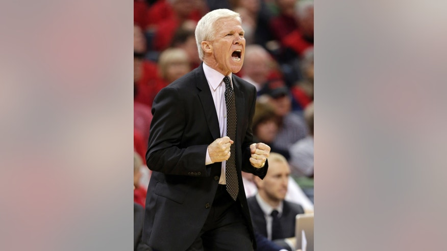 Davidson head coach Bob McKillop shouts at his team during the first half of an NCAA college basketball game against Virginia in Charlotte, N.C., Saturday, Nov. 16, 2013. (AP Photo/Chuck Burton)
