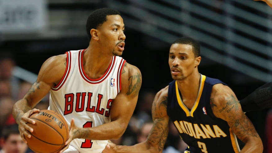 Chicago Bulls guard Derrick Rose (1) looks to pass the ball against Indiana Pacers guard George Hill (3) during a first quarter of an NBA basketball game in Chicago, Saturday, Nov. 16, 2013. (AP Photo/Kamil Krzaczynski)