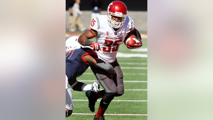 Washington State's Marcus Mason (35) is dragged down by Arizona's William Parks (11) in the first half of an NCAA college football game on Saturday, Nov. 16, 2013, in Tucson, Ariz. (AP Photo/John MIller)