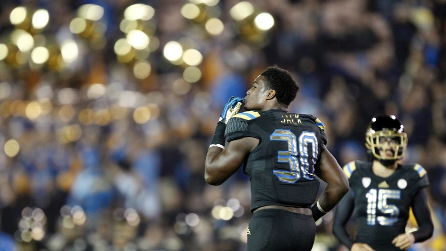 UCLA running back Myles Jack (30) celebrates after his third touchdown against Washington, in the second quarter of an NCAA college football game Friday, Nov. 15, 2013, in Pasadena, Calif. Jones was penalized for taunting on the play. (AP Photo/Alex Gallardo)