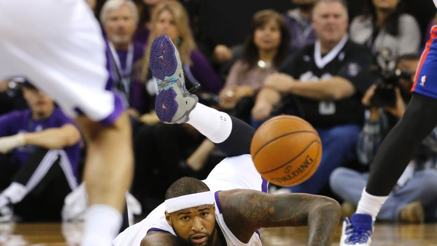 Sacramento Kings center DeMarcus Cousins goes to the floor as he chases the ball during the first quarter against the Detroit Pistons in an NBA basketball game in Sacramento, Calif., Friday, Nov. 15, 2013. (AP Photo/Rich Pedroncelli)