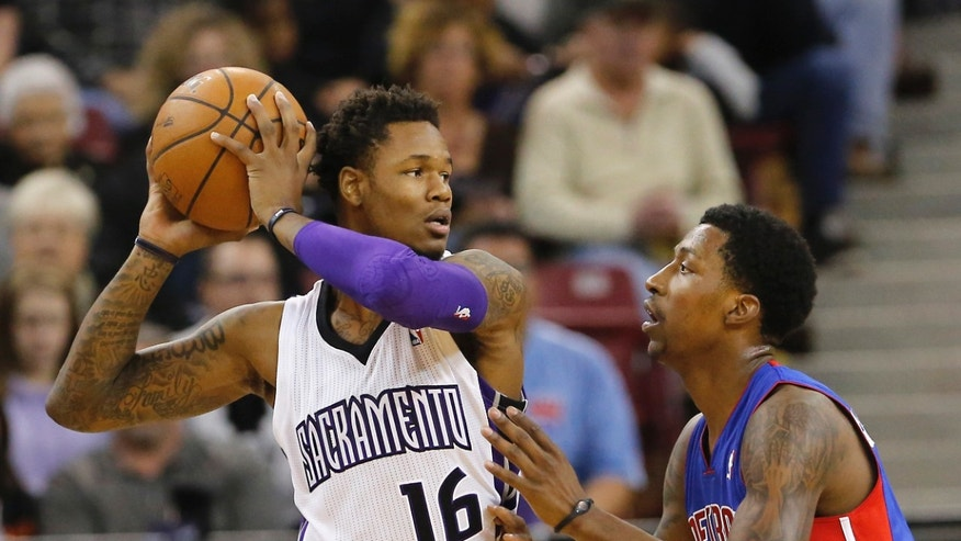 Sacramento Kings guard Ben McLemore, left, protects the ball from Detroit Pistons guard Brandon Jennings during the first quarter of an NBA basketball game in Sacramento, Calif., Friday, Nov. 15, 2013. (AP Photo/Rich Pedroncelli)