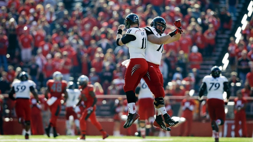 Cincinnati quarterback Brendon Kay (11) celebrates a touchdown with Eric Lefeld (71) during the first half of an NCAA college football game against Rutgers in Piscataway, N.J., Saturday, Nov. 16, 2013.   (AP Photo/Mel Evans)