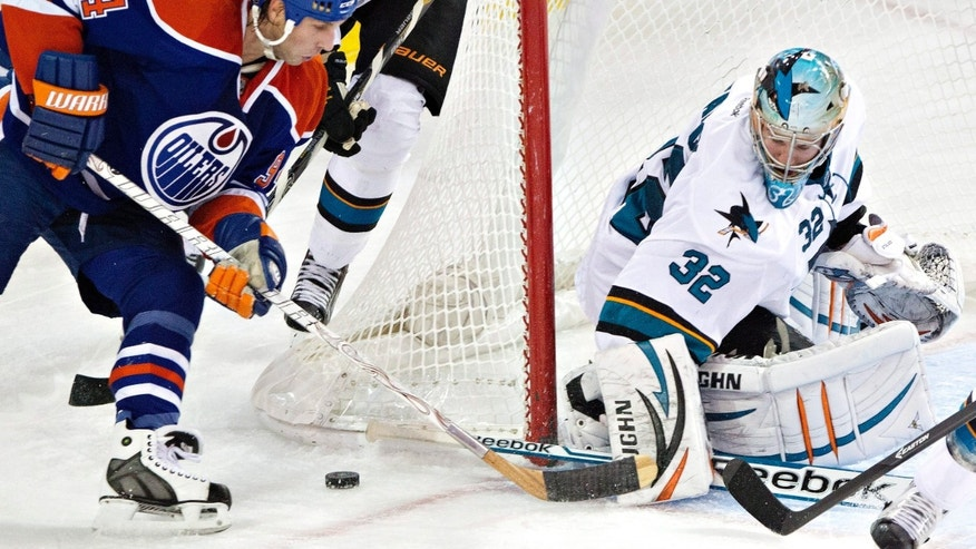 San Jose Sharks goalie Alex Stalock (32) makes the save on Edmonton Oilers' Ryan Smyth (94) during the second period of an NHL hockey game Friday, Nov. 15, 2013, in Edmonton, Alberta. (AP Photo/The Canadian Press, Jason Franson)
