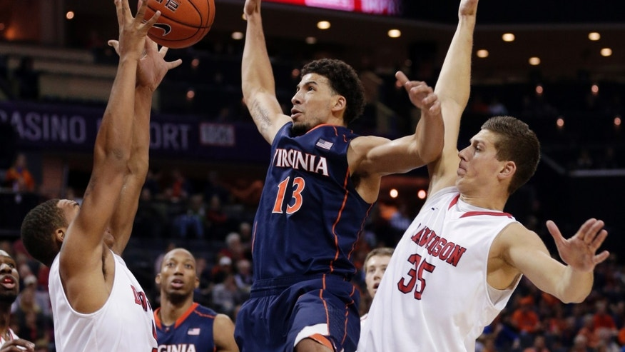 Virginia's Anthony Gill (13) loses the ball as he is trapped by Davidson's Chris Czerapowicz (35) and Jordan Barham (5) during the first half of an NCAA college basketball game in Charlotte, N.C., Saturday, Nov. 16, 2013. (AP Photo/Chuck Burton)