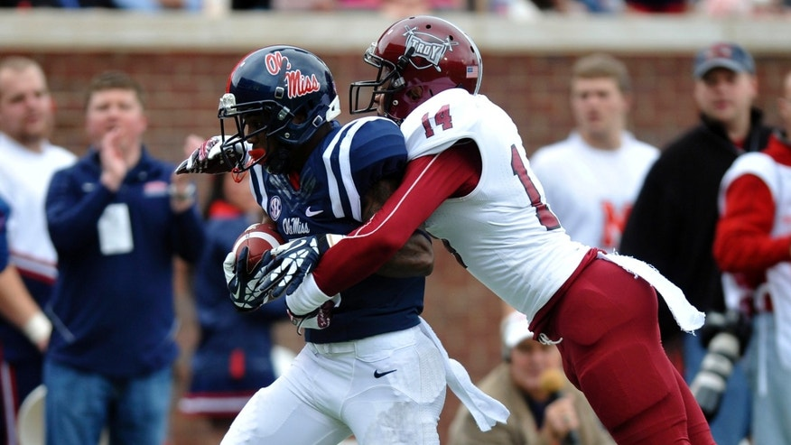 Mississippi running back I'Tavius Mathers (5) scores on a pass play as Troy safety Rishad Goode (14) defends  during an NCAA college football game in Oxford, Miss., Saturday, Nov. 16, 2013. (AP Photo/Oxford Eagle, Bruce Newman) MAGS OUT, NO SALES, MANDATORY CREDIT