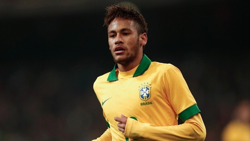 BEIJING, CHINA - OCTOBER 15: Neymar of Brazil in action during the international friendly match between Brazil and Zambia at Beijing National Stadium on October 15, 2013 in Beijing, China. (Photo by Lintao Zhang/Getty Images)