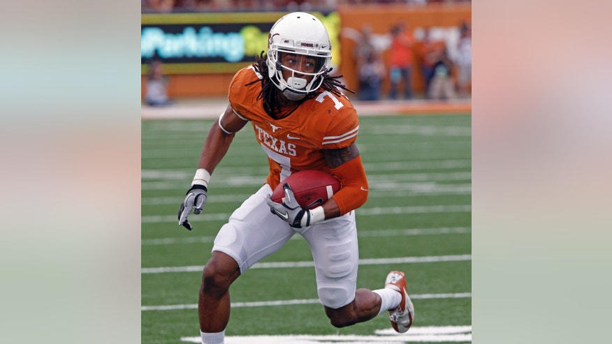Texas receiver Marcus Johnson runs with a reception against Oklahoma State during the second quarter of an NCAA college football game Saturday, Nov. 16, 2013, in Austin, Texas. (AP Photo/Michael Thomas)