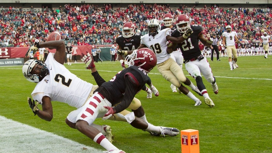 Central Florida wide receiver Jeff Godfrey (2) misses a touchdown pass as Temple defensive back Tavon Young (25) coveres during the second quarter of an NCAA college football game, Saturday, Nov. 16, 2013, in Philadelphia.  (AP Photo/Chris Szagola)