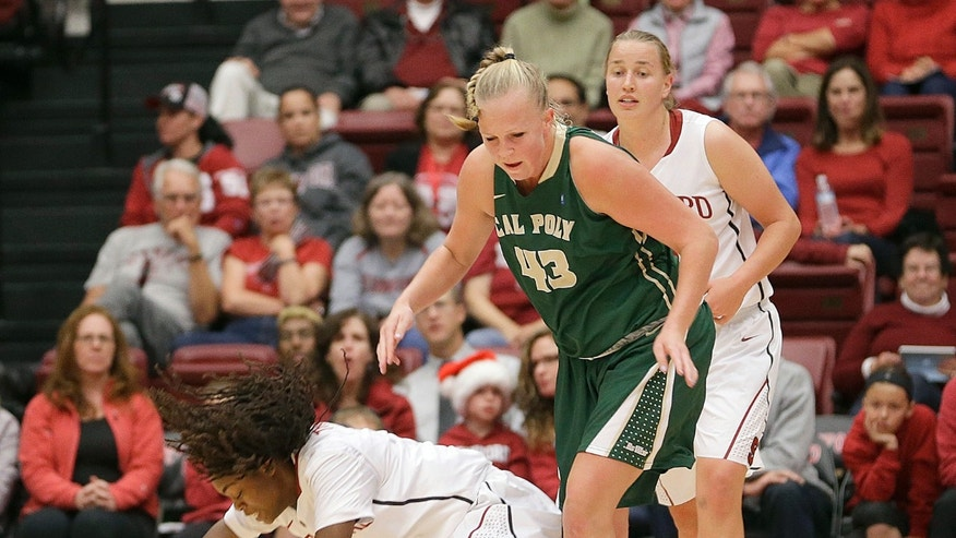 Stanford's Lili Thompson, left, collides with Cal Poly's Molly Schlemer (43) during the first half of an NCAA college basketball game in Stanford, Calif., Friday, Nov. 15, 2013. (AP Photo/Tony Avelar)