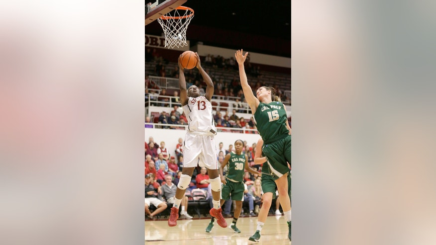 Stanford's Chiney Ogwumike (13) drives to the basket against Cal Poly's Taryn Garza (15) during the first half of an NCAA college basketball game in Stanford, Calif., Friday, Nov. 15, 2013. (AP Photo/Tony Avelar)