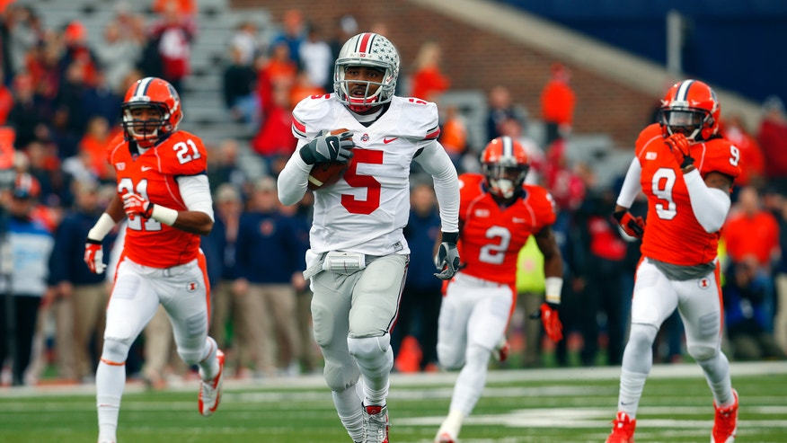 Ohio State quarterback Braxton Miller (5) runs for a 70 yard touchdown as Illinois defensive back Zane Petty (21) defensive back V'Angelo Bentley (2) and defensive back Earnest Thomas III (9) chase him during the first half of an NCAA college football game on Saturday, Nov. 16, 2013, in Champaign, Ill. (AP Photo/Jeff Haynes)