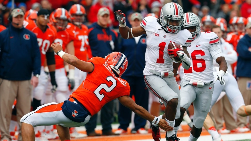 Ohio State cornerback Bradley Roby (1) avoids Illinois quarterback Nathan Scheelhaase (2) as he returns an interception a 63-yards for a touchdown during the first half of an NCAA college football game on Saturday, Nov. 16, 2013, in Champaign, Ill. (AP Photo/Jeff Haynes)
