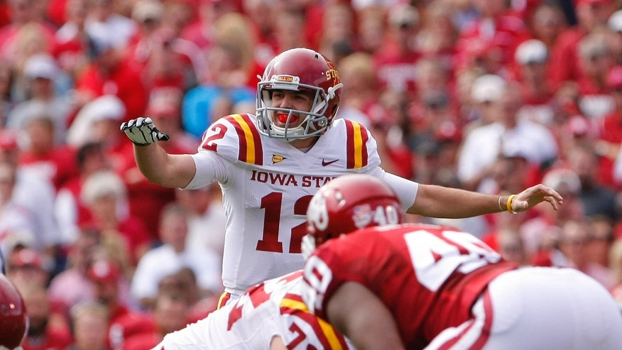 Iowa State quarterback Sam Richardson calls a play against Oklahoma in the first quarter of an NCAA college football game in Norman, Okla., on Saturday, Nov. 16, 2013.  (AP Photo/Alonzo Adams)