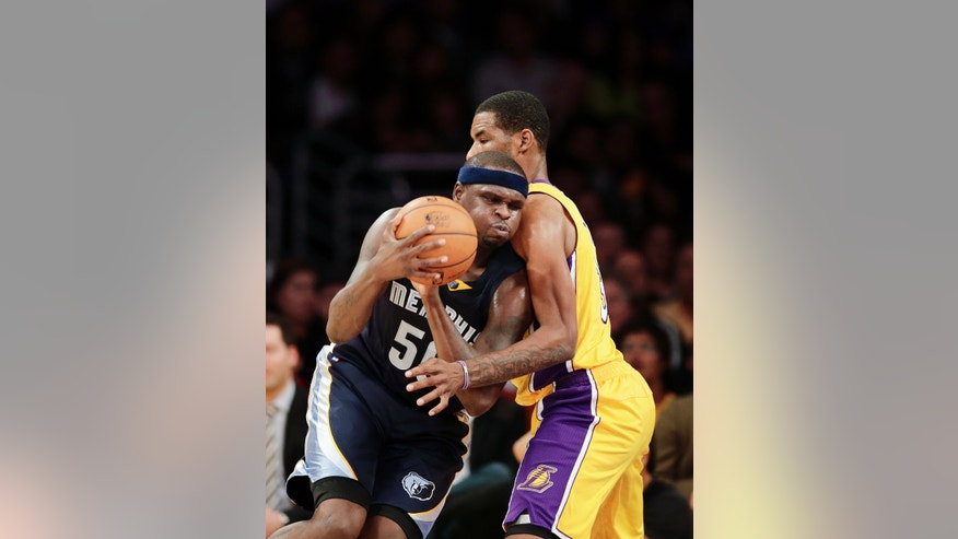 Memphis Grizzlies' Zach Randolph, left, is defended by Los Angeles Lakers' Shawne Williams during the first half of an NBA basketball game on Friday, Nov. 15, 2013, in Los Angeles. (AP Photo/Jae C. Hong)