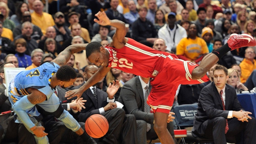 Marquette's 's Todd Mayo (4) and Ohio State's' Sam Thompson (12) collide as the ball goes out-of-bounds during the first half of an NCAA college basketball game Saturday, Nov. 16, 2013, in Milwaukee. (AP Photo/Jim Prisching)