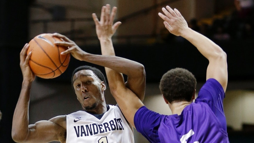 Vanderbilt guard Eric McClellan (1) becomes entangled with Lipscomb guard J.J. Butler (5) in the first half of an NCAA college basketball game on Friday, Nov. 15, 2013, in Nashville, Tenn. (AP Photo/Mark Humphrey)