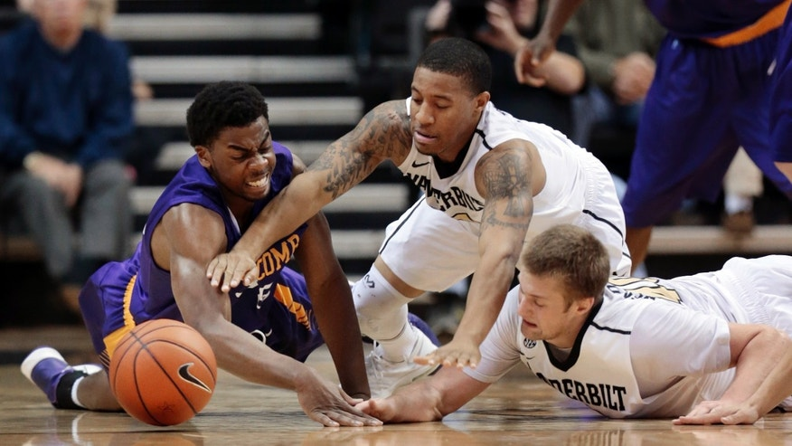 Lipscomb forward Martin Smith, left, fights for the ball with Vanderbilt players Kyle Fuller, center, and Josh Henderson, right, in the second half of an NCAA college basketball game on Friday, Nov. 15, 2013, in Nashville, Tenn. Vanderbilt won 80-69. (AP Photo/Mark Humphrey)