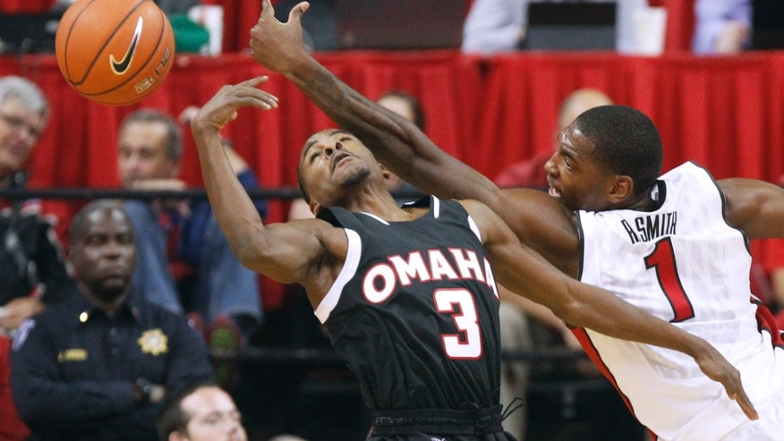 Omaha guard Devin Patterson (3) and UNLV forward Roscoe Smith reach for a rebound during their NCAA college basketball game on Friday, Nov. 15, 2013, in Las Vegas. (AP Photo/Las Vegas Sun, Sam Morris) LAS VEGAS REVIEW JOURNAL OUT