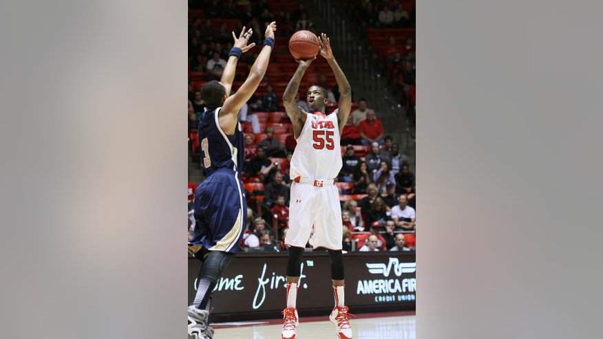 Utah guard Delon Wright (55) shoots a jumper over the defense of UC Davis guard Corey Hawkins (3) during the first half of an NCAA college basketball game Friday, Nov. 15, 2013, in Salt Lake City. (AP Photo/The Salt Lake Tribune, Scott Sommerdorf) DESERET NEWS OUT  LOCAL TV OUT  MAGS OUT