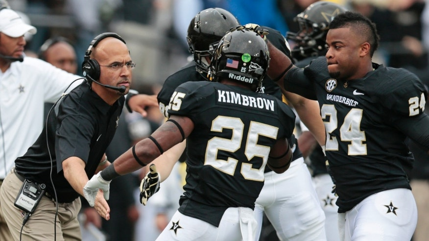 Vanderbilt running back Brian Kimbrow (25) is congratulated by head coach James Franklin, left, and Wesley Tate (24) after Kimbrow scored a touchdown on a 21-yard run against Kentucky in the first quarter of an NCAA college football game on Saturday, Nov. 16, 2013, in Nashville, Tenn. (AP Photo/Mark Humphrey)