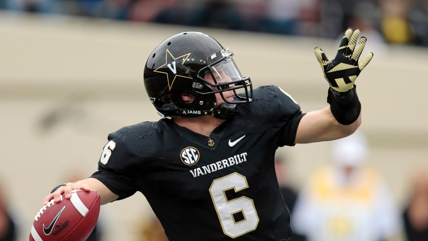 Vanderbilt quarterback Austyn Carta-Samuels passes against Kentucky in the second quarter of an NCAA college football game on Saturday, Nov. 16, 2013, in Nashville, Tenn. (AP Photo/Mark Humphrey)