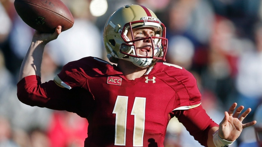 Boston College quarterback Chase Rettig (11) passes in the second quarter of an NCAA college football game against the North Carolina State in Boston, Saturday, Nov. 16, 2013. (AP Photo/Michael Dwyer)
