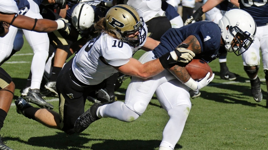 Penn State running back Bill Belton (1) drags Purdue linebacker Sean Robinson (10) into the end zone for a first-quarter touchdown during an NCAA college football game in State College, Pa., Saturday, Nov. 16, 2013. (AP Photo/Gene J Puskar)