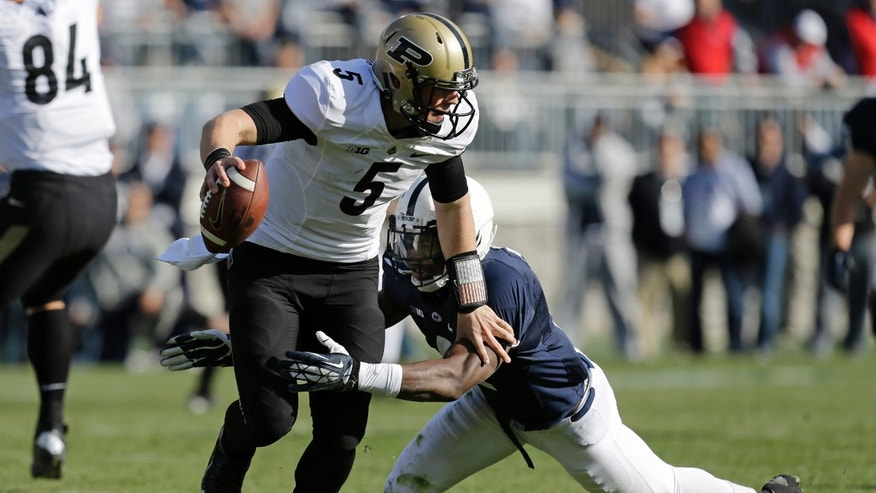 Purdue quarterback Danny Etling (5) is sacked by Penn State safety Adrian Amos (4) for a 12-yard loss during the second quarter of an NCAA college football game in State College, Pa., Saturday, Nov. 16, 2013. (AP Photo/Gene J Puskar)