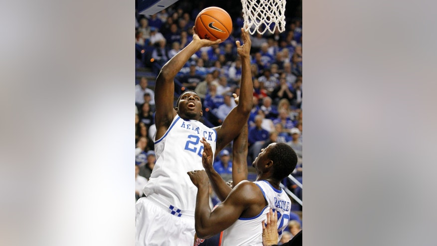Kentucky's Alex Poythress, left, shoots next to teammate Julius Randle during the first half of an NCAA college basketball game against Robert Morris, Sunday, Nov. 17, 2013, in Lexington, Ky. (AP Photo/James Crisp)