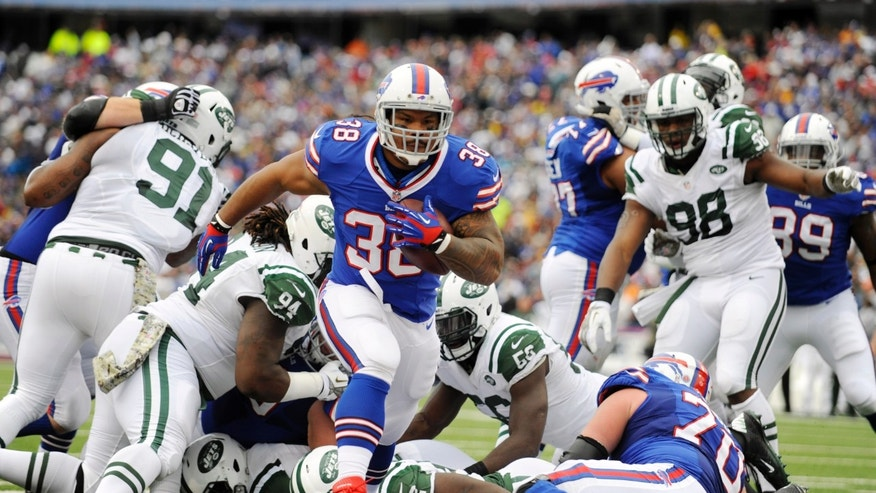 Buffalo Bills fullback Frank Summers (38) scores a touchdown against the New York Jets during the first half of an NFL football game on Sunday, Nov. 17, 2013, in Orchard Park, N.Y. (AP Photo/Gary Wiepert)