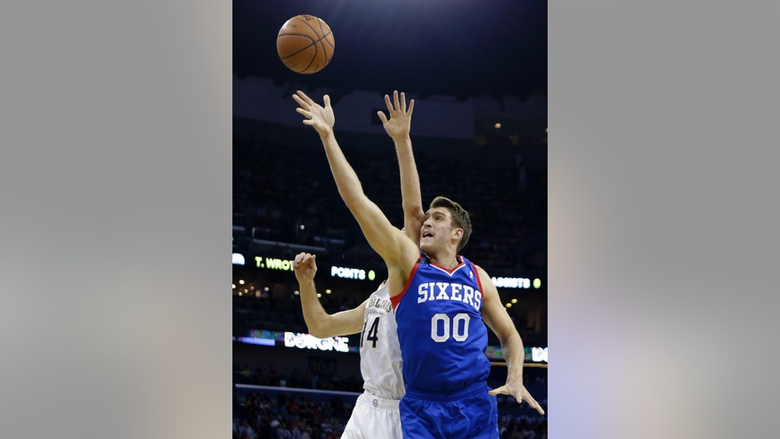 Philadelphia 76ers center Spencer Hawes (00) goes to the basket against New Orleans Pelicans center Jason Smith (14) in the first half of an NBA basketball game in New Orleans, Saturday, Nov. 16, 2013. (AP Photo/Gerald Herbert)