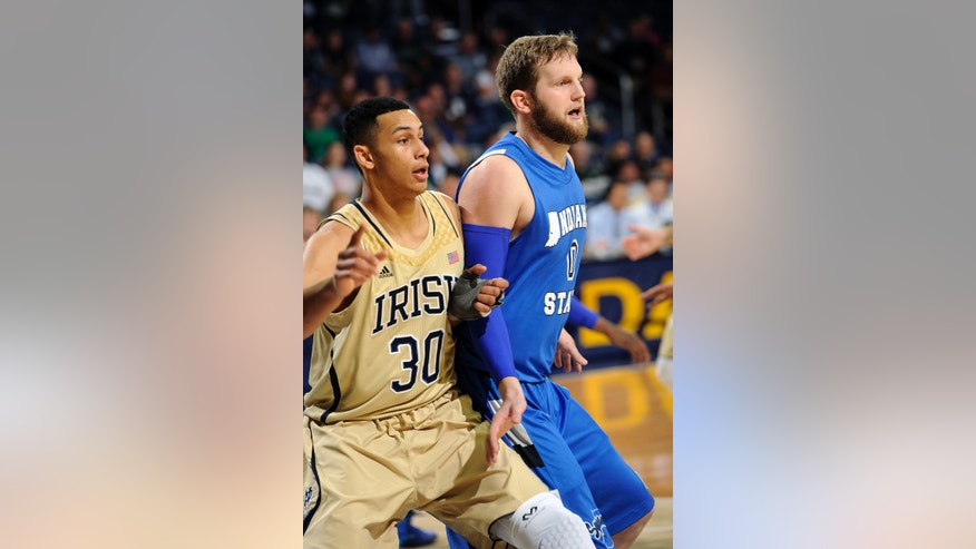 Notre Dame forward Zack Auguste, left, battles for rebounding position with Indiana State forward Jake Kitchell during the first half of an NCAA college basketball game on Sunday, Nov. 17, 2013, in South Bend, Ind. (AP Photo/Joe Raymond)