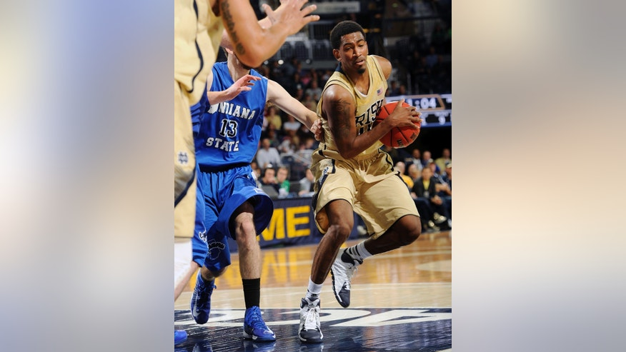 Notre Dame guard Eric Atkins, right, drives down the lane as Indiana State guard Jake Odum defends during the first half of an NCAA college basketball game on Sunday, Nov. 17, 2013, in South Bend, Ind. (AP Photo/Joe Raymond)
