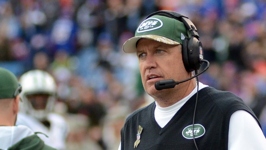 New York Jets head coach Rex Ryan walks on the sidelines during the first half of an NFL football game against the Buffalo Bills on Sunday, Nov. 17, 2013, in Orchard Park, N.Y. Buffalo won 37-14. (AP Photo/Heather Ainsworth)