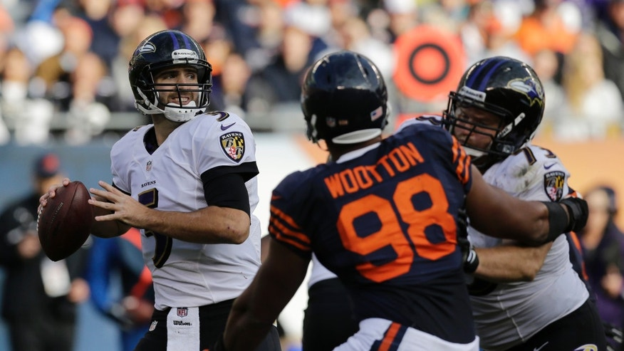 Baltimore Ravens quarterback Joe Flacco (5) looks to throw a pass during the first half of an NFL football game against the Chicago Bears, Sunday, Nov. 17, 2013, in Chicago. Play resumed after a severe storm blew through the area and suspended play for about two hours. (AP Photo/Nam Y. Huh)