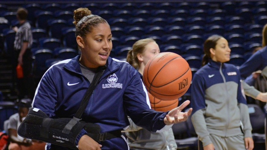 Sidelined by an injury, Connecticut's Kaleena Mosqueda-Lewis (23) catches balls for teammates before an NCAA college basketball game against Penn State, Sunday, Nov. 17, 2013, in State College, Pa. (AP Photo/John Beale)