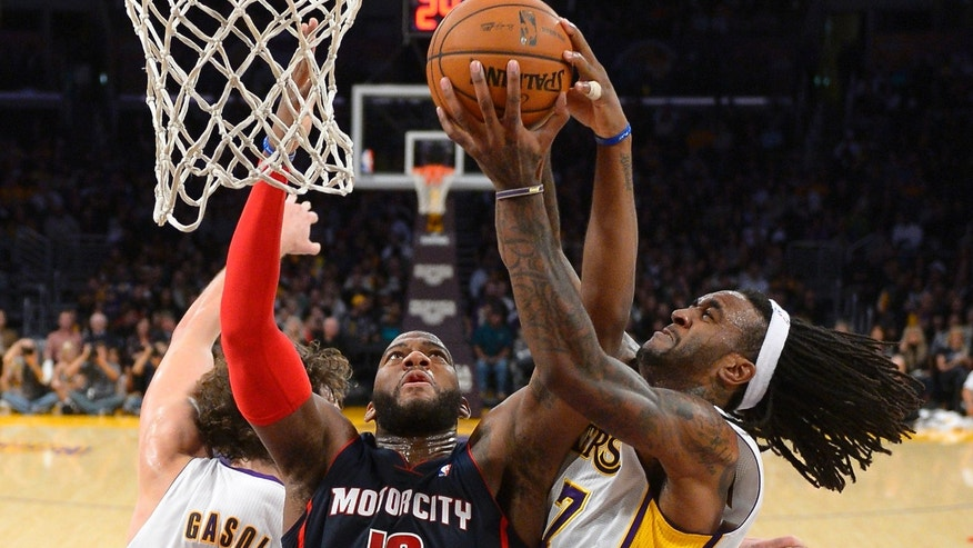 Detroit Pistons forward Greg Monroe, center, battles for a rebound with Los Angeles Lakers center Jordan Hill, right, and center Pau Gasol, of Spain, during the first half of an NBA basketball game Sunday, Nov. 17, 2013, in Los Angeles. (AP Photo/Mark J. Terrill)