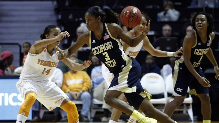 Georgia Tech guard Kaela Davis (3) looses control of the ball as she's pressured by Tennessee guard Andraya Carter (14) in the seond half of an NCAA college basketball game on Sunday, Nov. 17, 2013, in Knoxville, Tenn. Tennessee won 87-76. (AP Photo/Wade Payne)